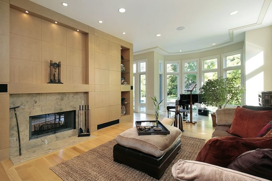 The hardwood flooring in this naturally lit living room is unified ...