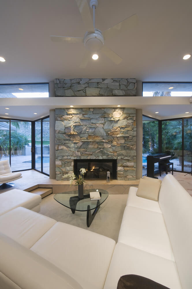 25 cozy living rooms with fireplaces - Large contemporary stone fireplace ...