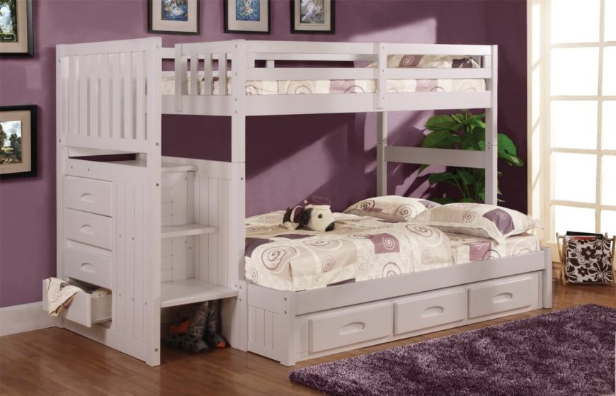 Here we have a more bespoke, white bunk bed with abundant built-in storage and a larger lower bunk. The stairs hide a cubby nook, while extra drawers emerge from the lower bunk frame.