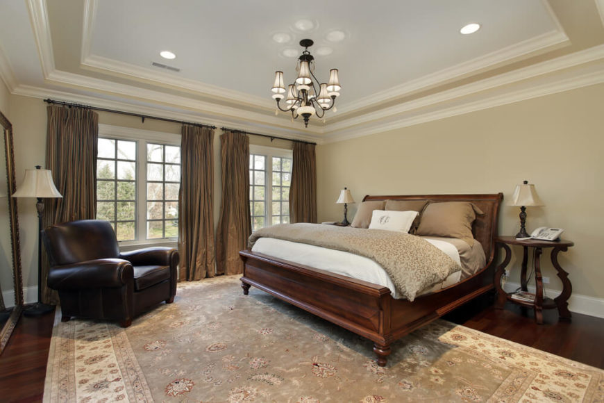 Simple elegance is evident in the bedroom featured above An extra large area  rug coordinates.
