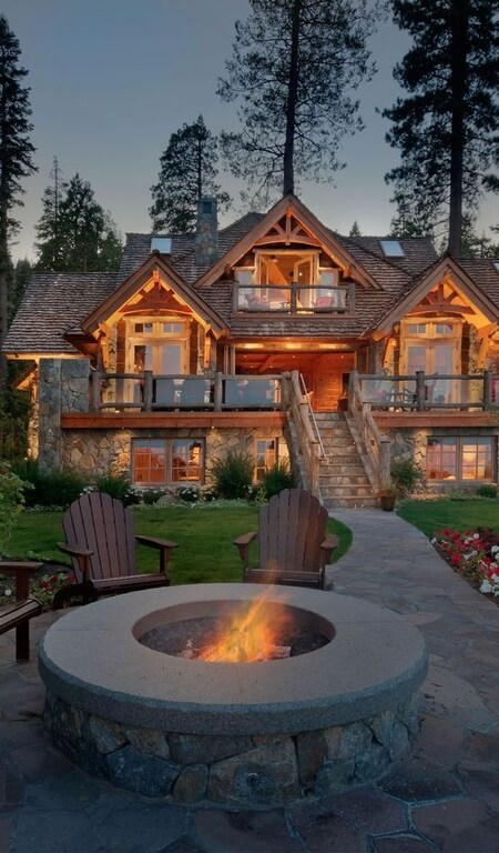 This home is simply breathtaking with all of it's glowing lights at dusk. Even though this home is modernized, it keeps it's rustic looking cedar shingles for a truly country look.