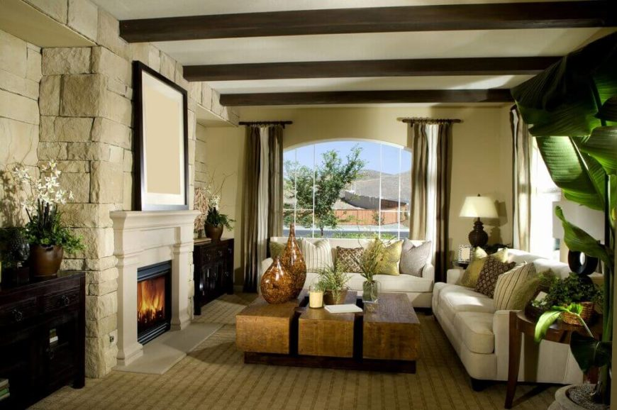the stone fireplace expands into an entire stone accent wall with two
