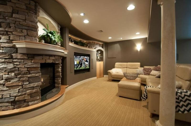 taupe walls of this living room merge into a stacked stone accent wall