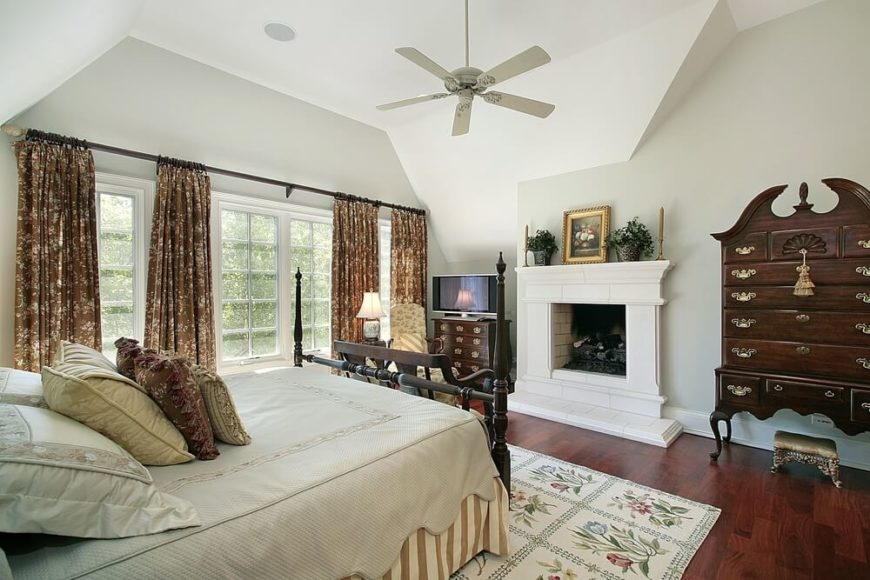 Dark  cherry toned hardwood flooring  an antique armoire  and matching 4  post bed. 24 Exceptional Bedrooms with Area Rugs  PICTURES