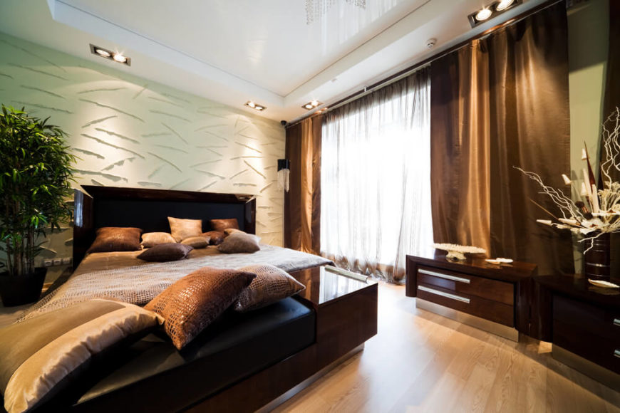 this bedroom space is all about texture dark modern furniture with clean lines and