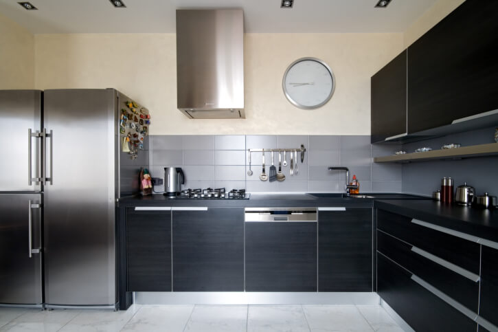 This Modernized Kitchen Is Simply Dazzling Lustrous Black Cabinets Encase This L Shaped Kitchen