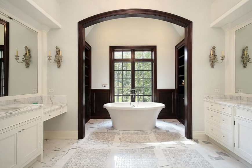 this bathroom has intricate marble and tile designs with accents of dark natural wood work