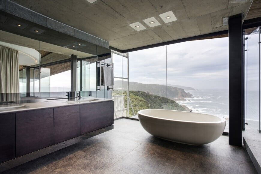 this is another design with a freestanding tub with a breathtaking view from this bathroom
