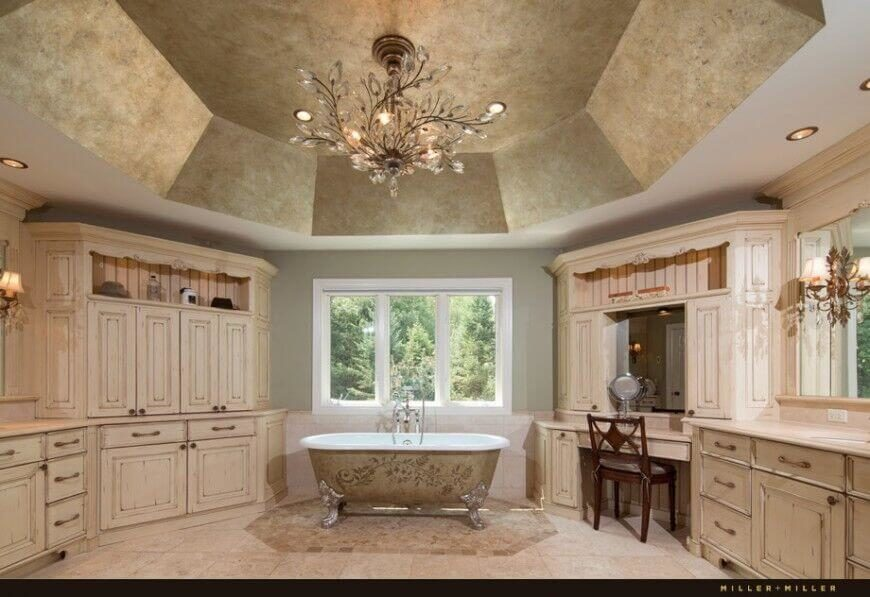 this country bathroom has beautiful rustic wood work and delicate designs the freestanding tub here