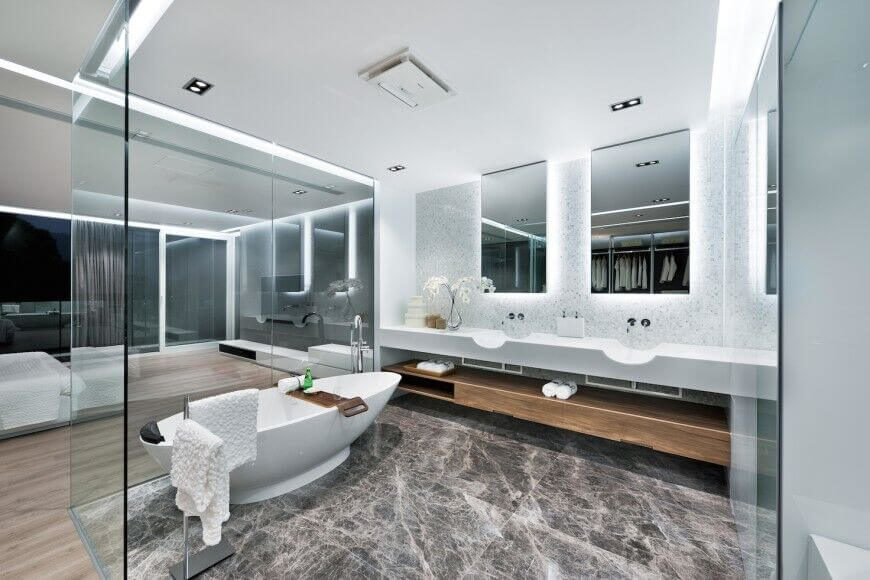 this bathroom is created entirely of glass walls in the center of the master bedroom