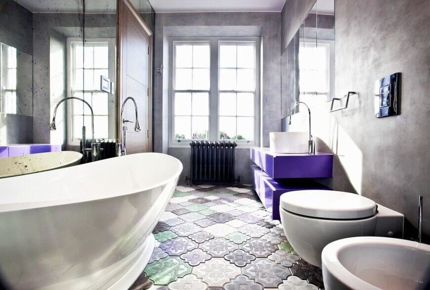 This Unique Bathroom Has Intricate Designs On The Floor And Has A Brilliant Purple Color