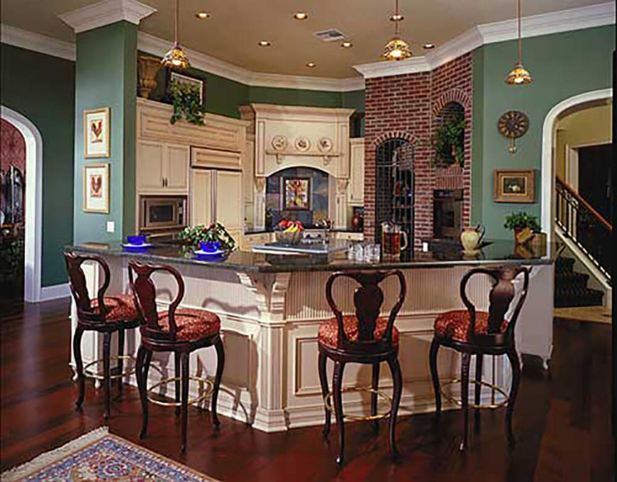 This Lavishly Colored Kitchen Maintains Its Cottage Kitchen Status With The  Excellent Use Of Exposed Brick