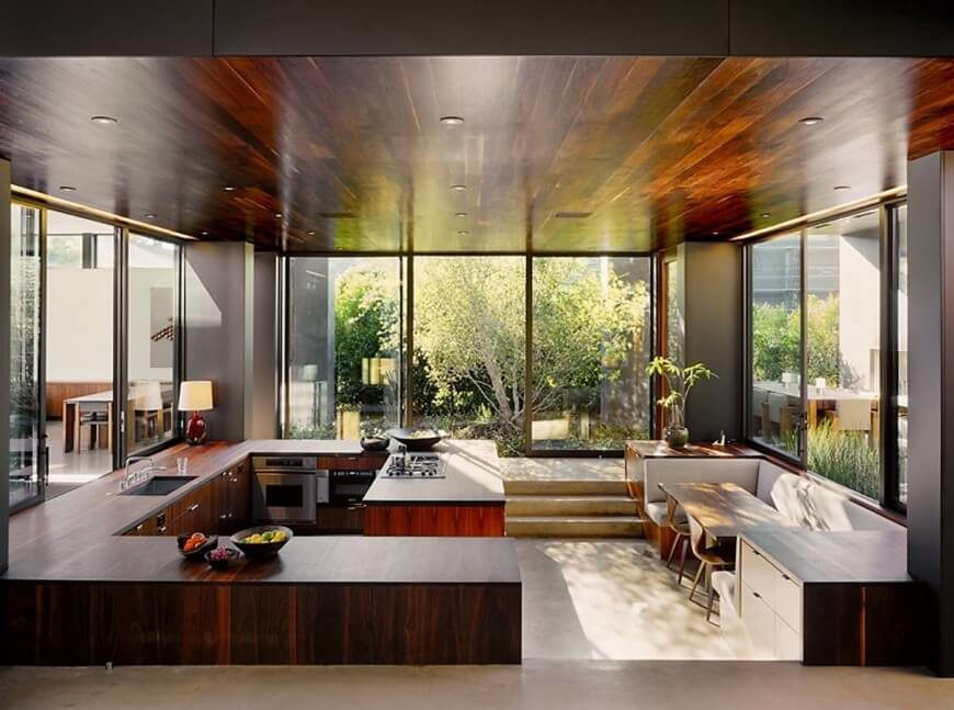 Returning To This Cozy Kitchen Surrounded By Wraparound Glazing The G Shape Of