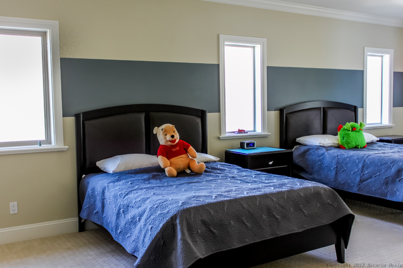 This Simple, Elegant Childrenu0027s Room Features Matching Black Beds With  Leather Headboard Upholstery And Textured