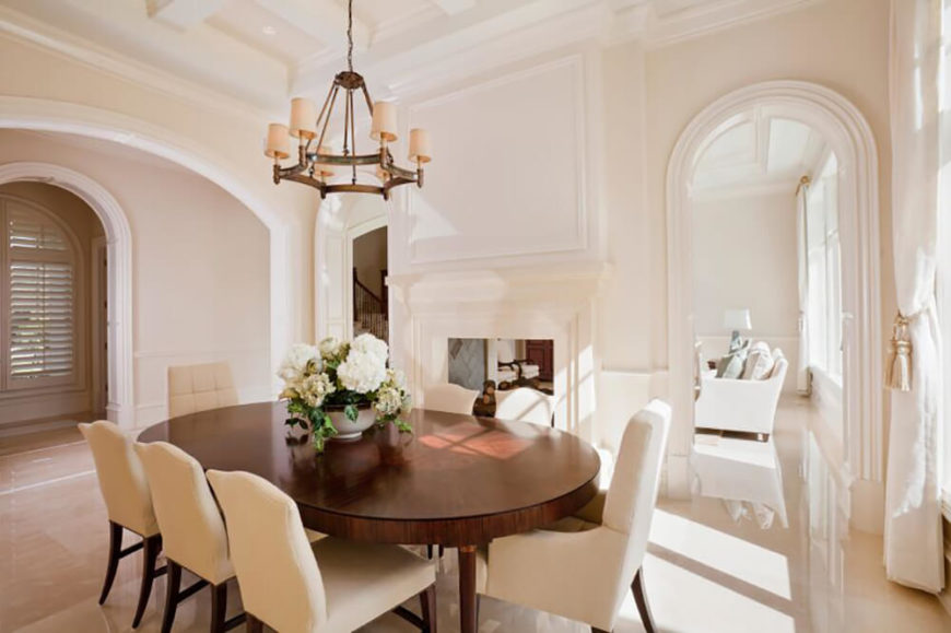 the chandelier in this lovely dining room pops against the pale walls and compliments the stunning - Contemporary Dining Room Chandeliers
