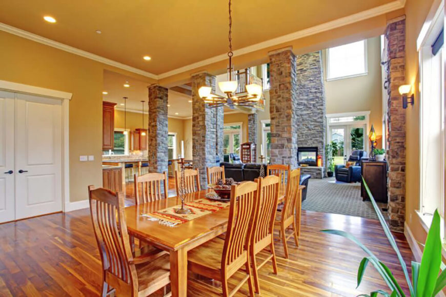 This Stunning Dining Room Features Lovely Hardwood Floors That Match The Set And Complement