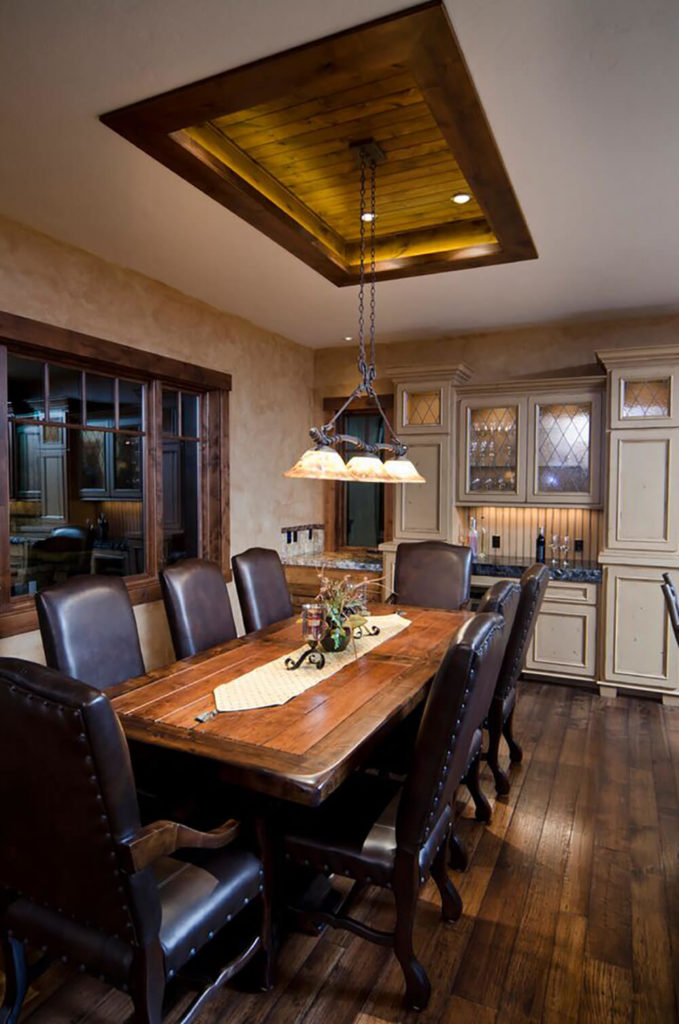 Heres A Traditional Open Plan Kitchen With Rich Hardwood Flooring And Dining Table To Match