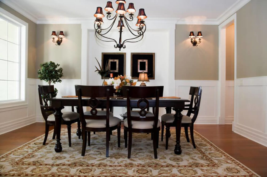 Stately Black Furniture Stands Out Against The Pale Walls And Area Rug Wrought Iron