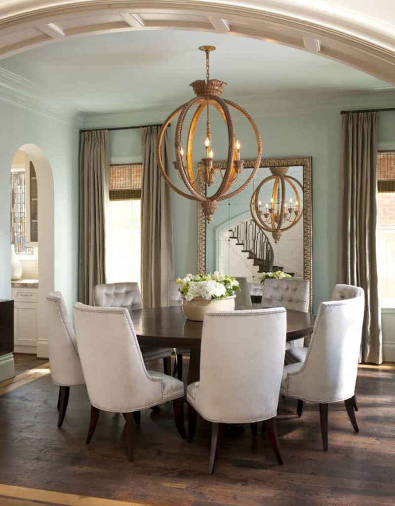 this glamorous dining room balances light walls with dark wood and features the astounding spherical chandelier suspended above the table - Dining Room Lighting Contemporary