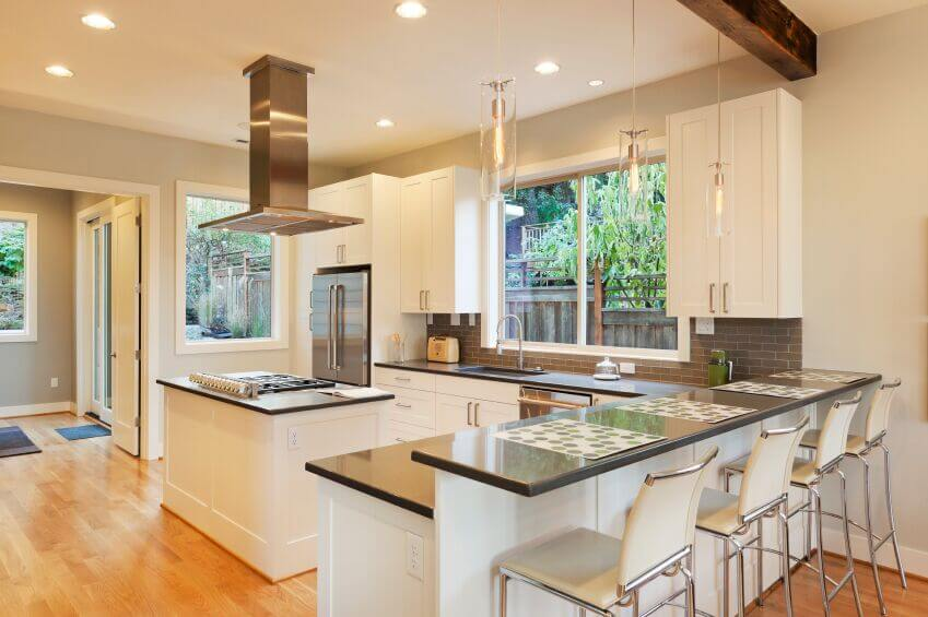 this beautiful bright kitchen utilizes the white and grey color scheme that is popular in