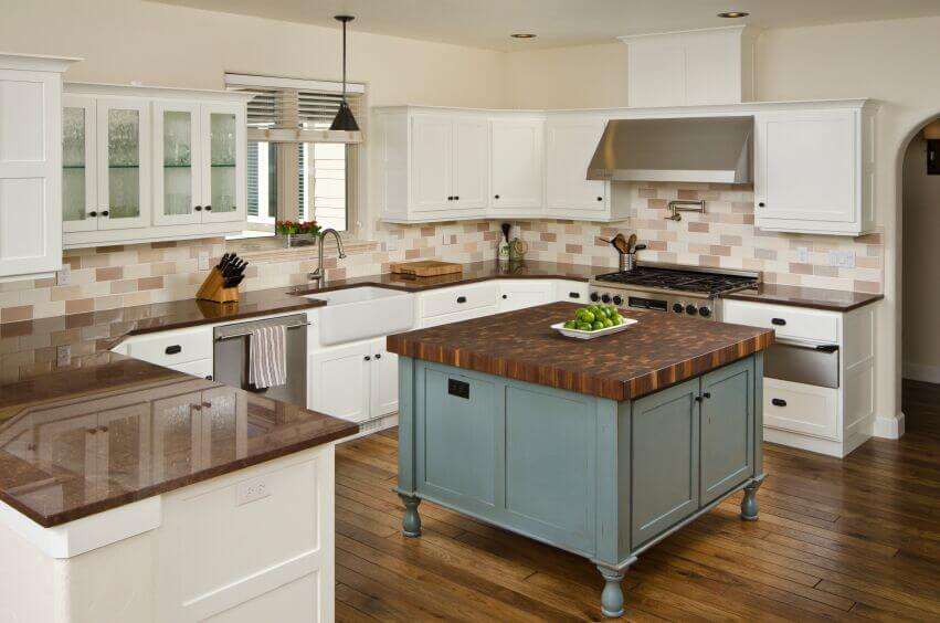 white cabinets are used to break up the warm tones of the room