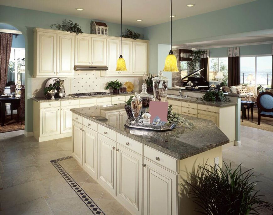 beautiful What Color Paint Goes With White Kitchen Cabinets #10: These stunning granite counters go well with the off-white cabinetry and  powder blue walls