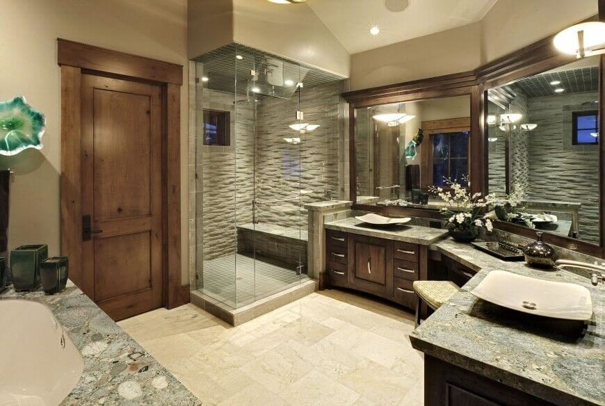 countertops adds texture of this beige and dark wood master bathroom