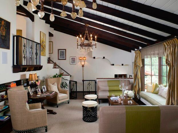 32 spectacular living room designs with exposed beams for Slanted ceiling design ideas