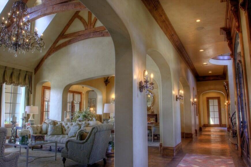32 spectacular living room designs with exposed beams for Arched ceiling beams