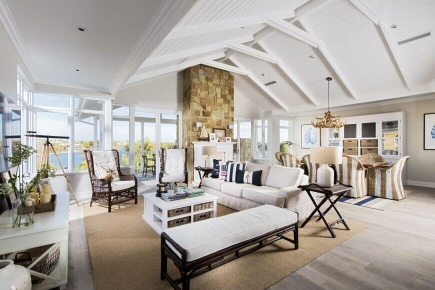 A Soaring Vaulted Ceiling In White With Exposed Beams Hangs Above This Vast Open Plan