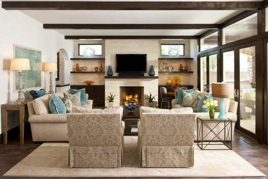in a more cozy living room centered on light stone fireplace dark exposed wood beams - Make Contemporary Furniture