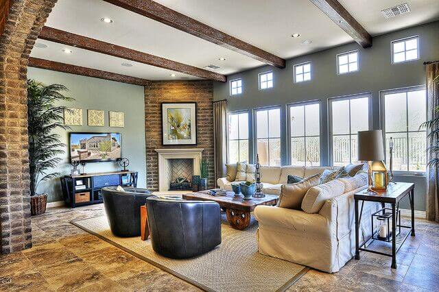 Large Format Tile Flooring Underpins This Living Room Beneath A Set Of  Massive Windows And A
