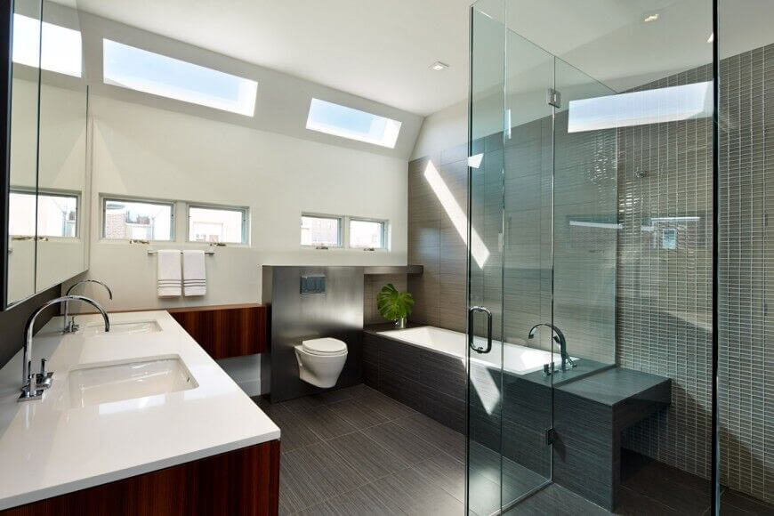 this striking bathroom keeps the room feelings spacious by utilizing glass around the large walk