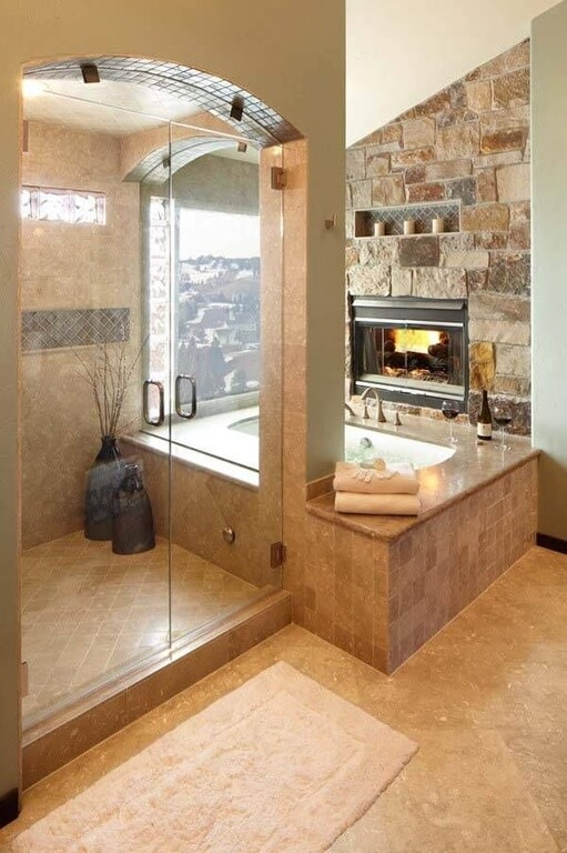 This Glass Enclosed Shower Looks Over The Tub And The Window While A  Fireplace Warms Up
