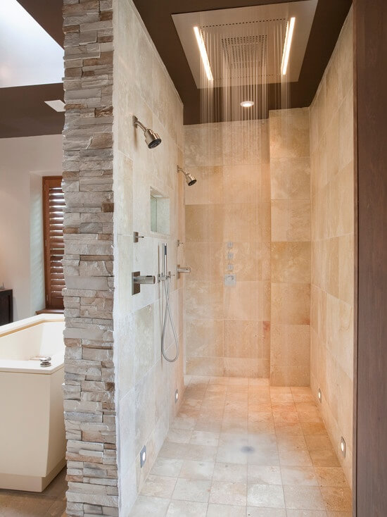 This Stunning Shower Is Surrounded By Creamy Marble Walls And Features A Rain Shower Head In