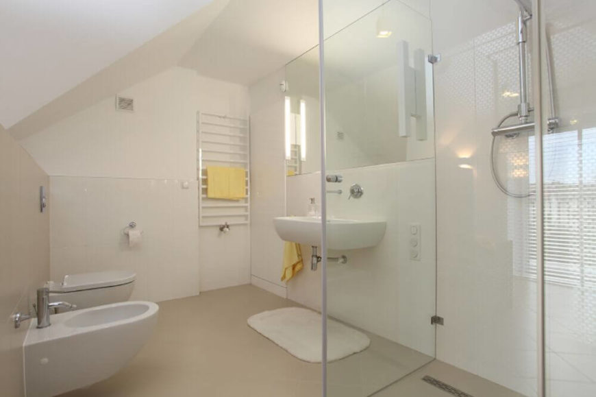durable flooring helps keep this small bathroom fully functional the open walkin shower