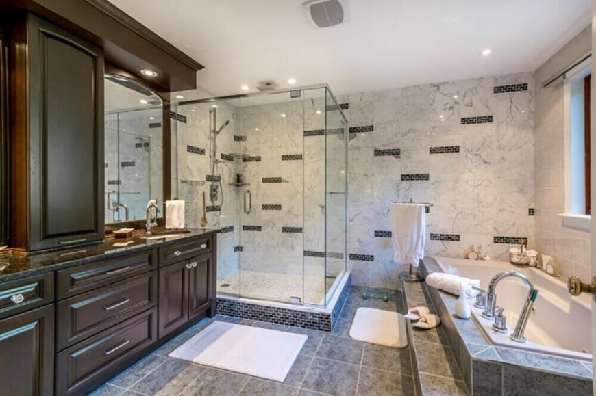 gorgeous tile walls off set the use of dark wood in this striking bathroom the