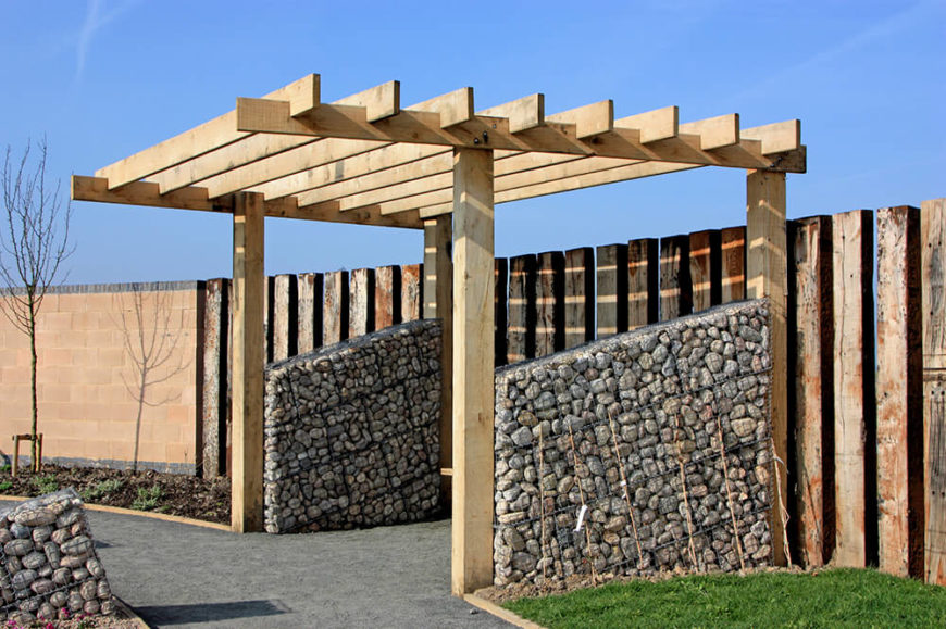 This pergola is simplified to fit the look of the rustic wooden fence ...