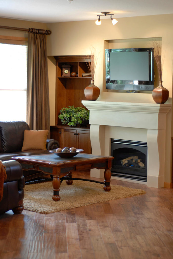 this fireplace is completely seamless and flows upwards towards the television the communal area