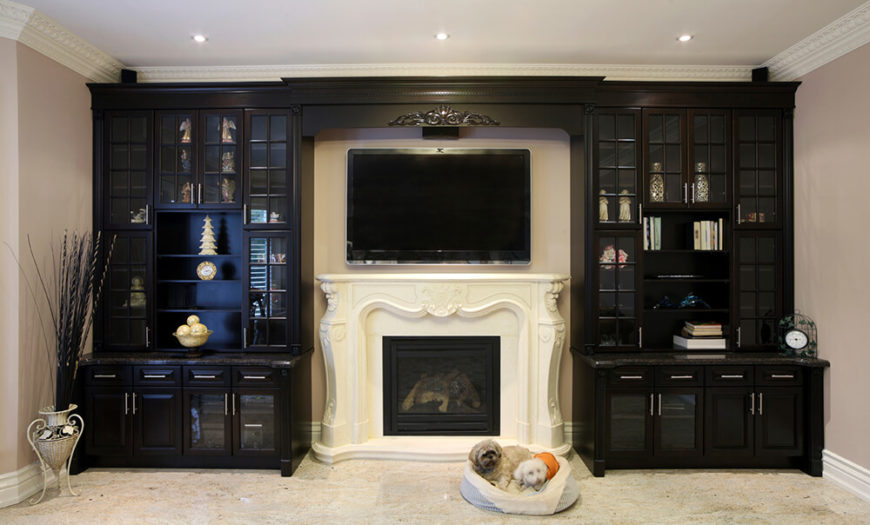 An Entertainment Center Surrounds The Plaster Fireplace And Television That Is Mounted Above It