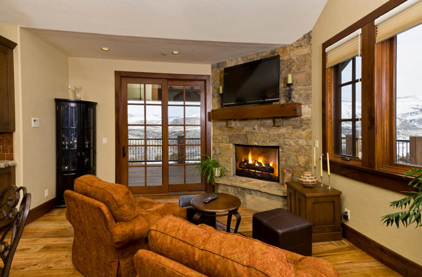 This Country Home Uses A Stone Fireplace For A Lavish Touch In Their Quaint  Living Room Part 58
