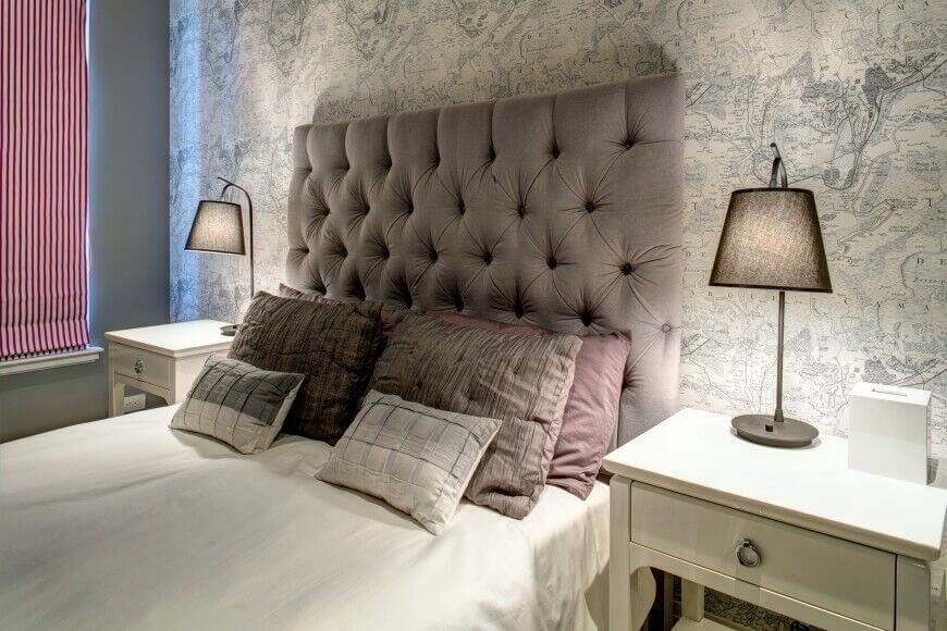 this accent wall resembles an old fashioned map and gives the bedroom a special character
