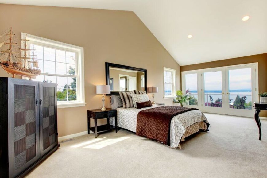 The High Ceiling And Amount Of Windows Make This Bedroom A Very Bright And Airy Space