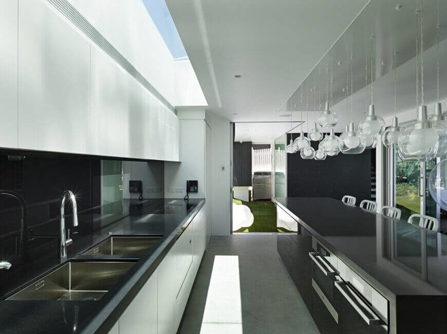 A large skylight is the main source of the light in this sleek, minimalist kitchen during the day, but in the evening these fun, bubble-shapes lights fill the room with a soft, glowing light.