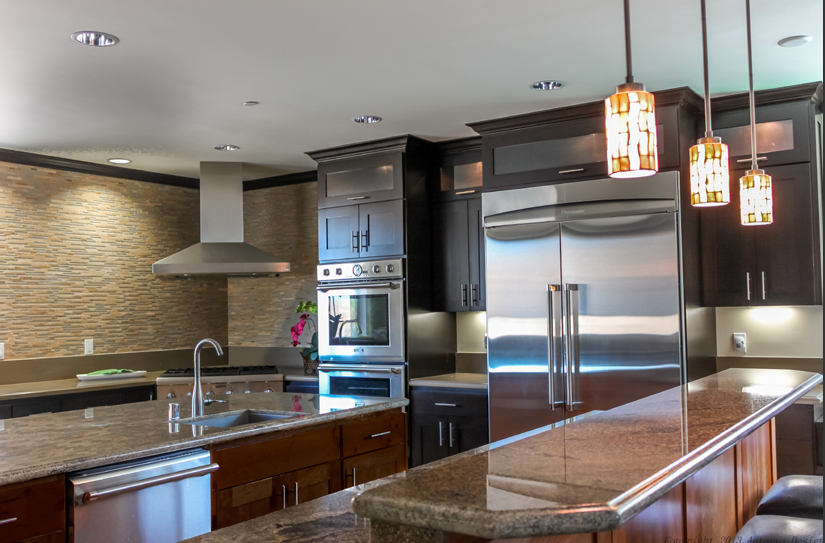These multi-colored pendants cast a warm, cozy glow over the granite  counters of