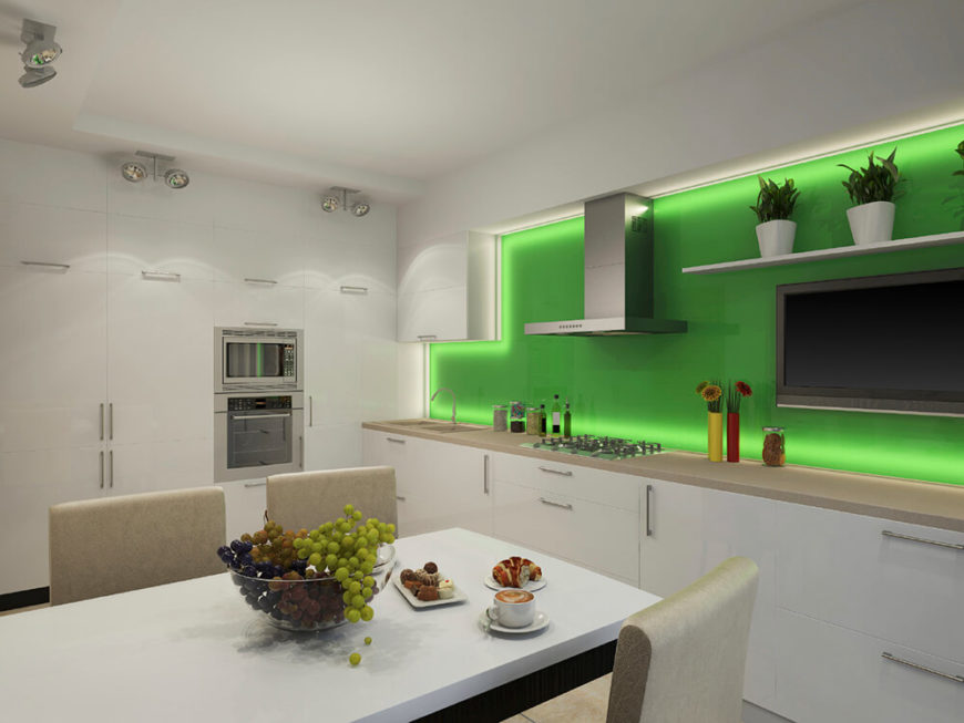 This funky, recessed lighting also illuminates the counter tops and cabinetry in this modern kitchen. The bright green accent wall creates a fun contrast to the white and beige tones of this room.