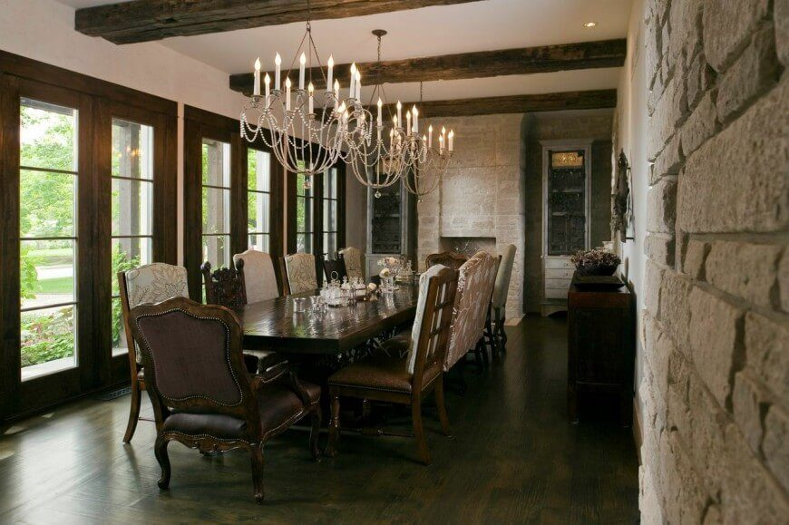 Dark Wood, Rough Stone, And Ornate Fabrics Bring This Room Back To An Age