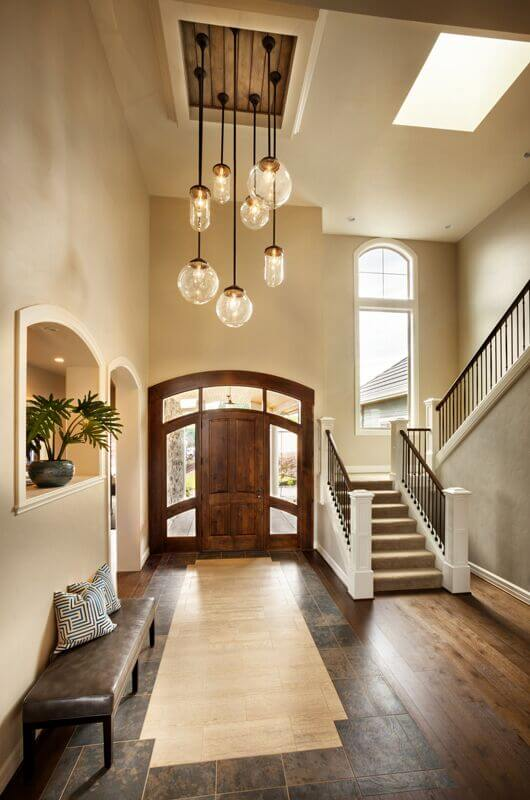 Another Long Foyer With A Corner Staircase And Archways Leading Into