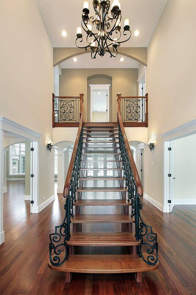 The central feature of this foyer is the wood and wrought iron staircase that leads up to the second floor and is located directly in the center of this lengthy, open foyer.