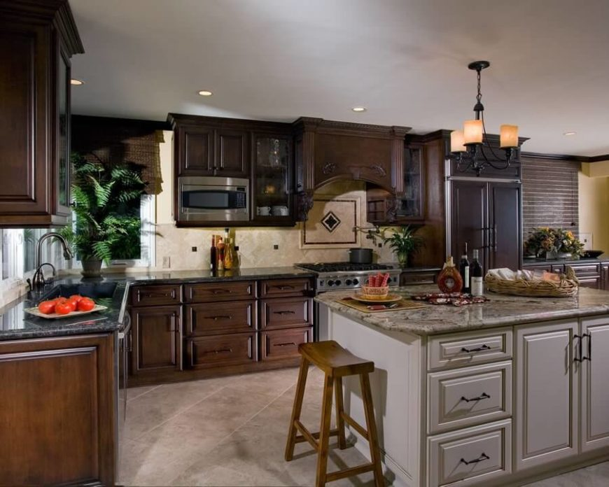 25 remarkable kitchens with dark cabinets and dark granite for Dark kitchen cabinets light island